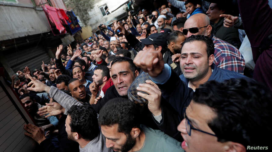 People attend the funeral of Egyptian police officer Mahmoud Abou El Yazied who was killed in a blast, in Cairo, Egypt Feb. 19, 2019.