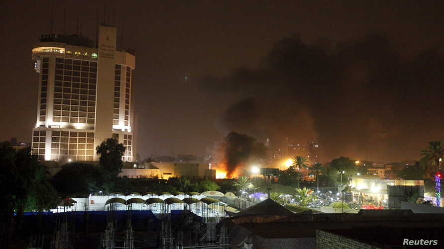Smoke rises from the site of car bomb attack in Baghdad, May 29, 2015.
