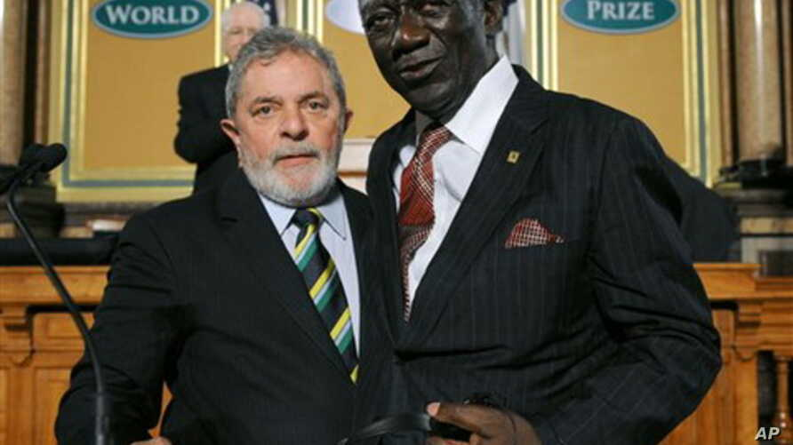 Former president of Ghana, John Agyekum Kufuor, right, and former president of Brazil, Luiz Inacio Lula Da Silva, receive the 2011 World Food Prize in Des Moines, Iowa on  Thursday, Oct. 13, 2011.