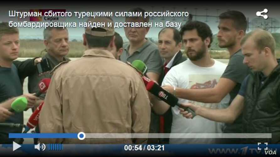 In the screen shot from www.1tv.ru, Captain Konstantin Murakhtin, the surviving airman of the downed Russian fighter jet, speaks to Russian TV journalists.