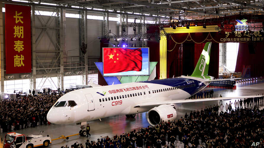 The first twin-engine 158-seater C919 passenger plane, seen in this Nov. 2, 2015 file photo, made by The Commercial Aircraft Corp. of China (COMAC) is pulled out of the company's hangar during a ceremony near the Pudong International Airport in Shang