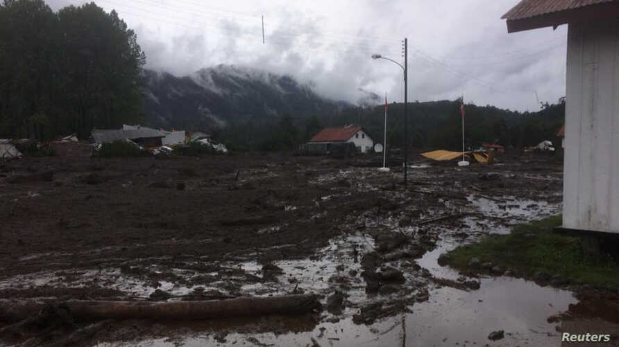 A landslide, brought on by a night of torrential rain, damaged Villa Santa Lucia, Los Lagos, Chile, Dec. 16, 2017.