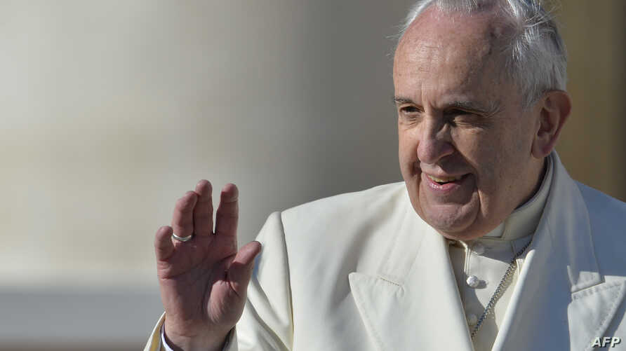 Pope Francis waves to the crowd during his general audience at St Peter's square at the Vatican on Dec. 10, 2014.