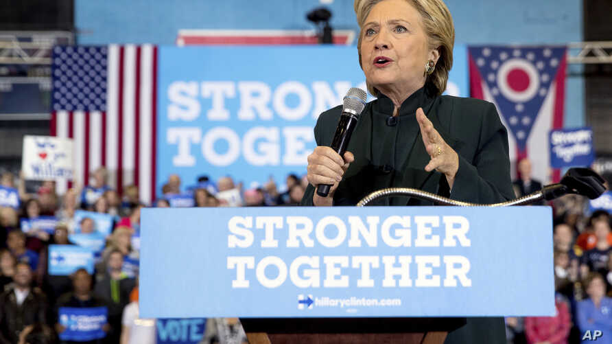 Campaign 2016 Black Activists Clinton: FILE - In this Friday, Oct. 21, 2016, file photo, Democratic presidential candidate Hillary Clinton speaks at a rally at Cuyahoga Community College in Cleveland. Some young black activists who had their doubts a