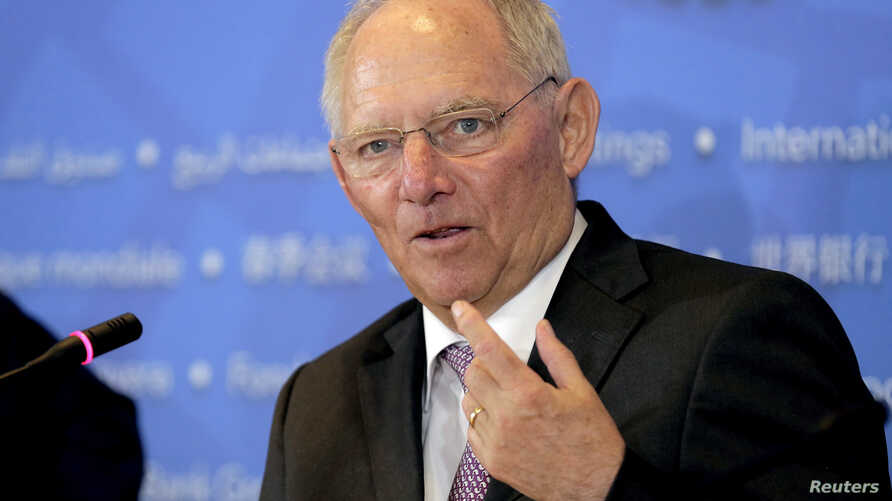FILE - German Finance Minister Wolfgang Schaeuble speaks during a news conference at the 2016 World Bank-IMF Spring Meeting in Washington, April 16, 2016.