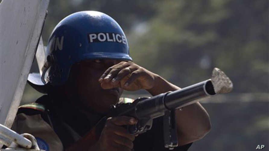 A stone hits the gun of a UN peacekeeper from Nigeria during a protest in Port-au-Prince, Haiti, Thursday, Nov. 18, 2010.
