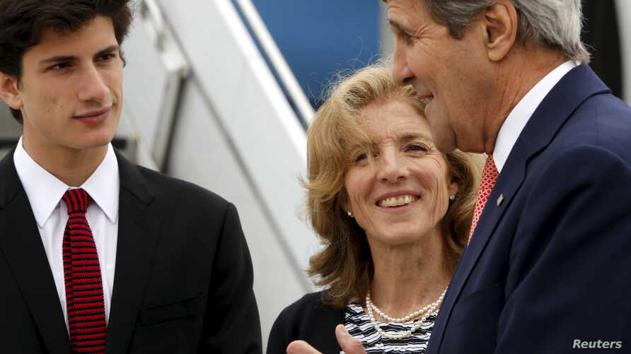 U.S. Ambassador to Japan Caroline Kennedy and her son, Jack Schlossberg, greet Secretary of State John Kerry as he arrives, ahead of G-7 foreign minister meetings, at Marine Corps Air Station Iwakuni, Japan, April 10, 2016.