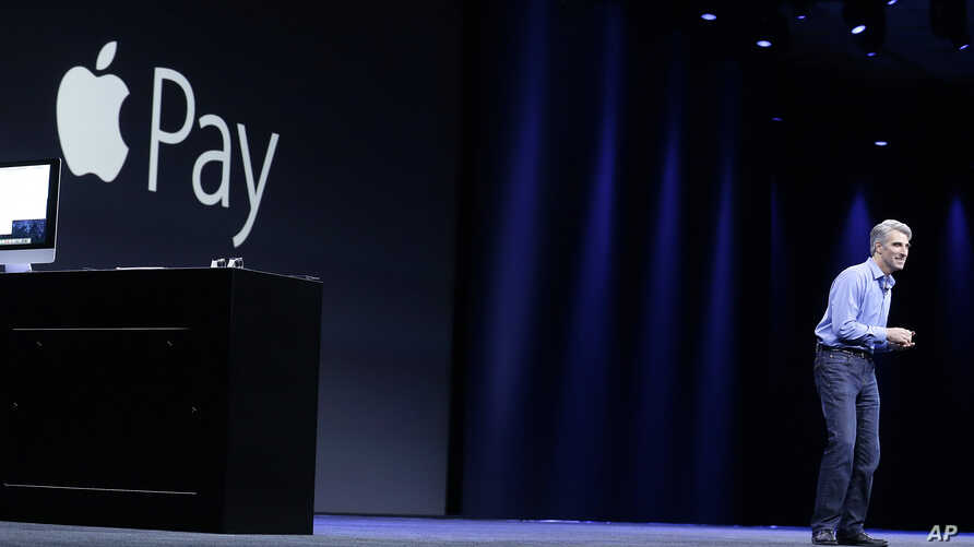 FILE - Craig Federighi, Apple senior vice president of Software Engineering, speaks about Apple Pay at the Apple Worldwide Developers Conference event in San Francisco, June 8, 2015.