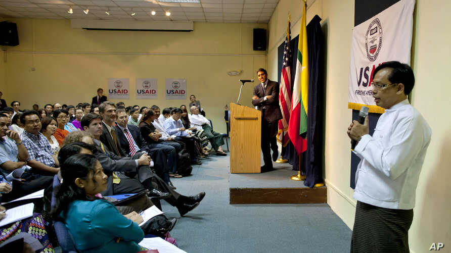 USAID head Rajiv Shah, second from right, watches Aung Naing, USAID Program development specialist, translates during an interactive session followed by a speech in Rangoon, Burma, March 7, 2013.