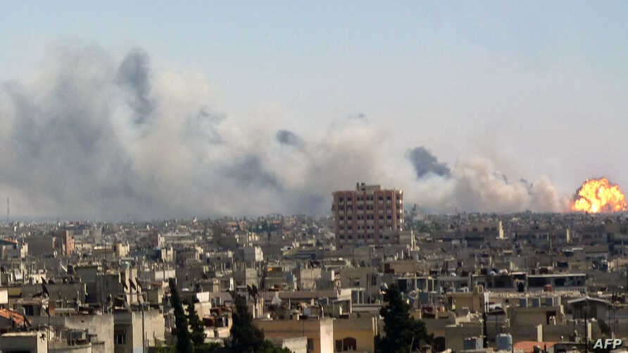 A handout image released by the Syrian opposition's Shaam News Network on August 1, 2013, shows flames billowing from the site of an ammunitions depot blast in the Wadi al-Zahab district of Homs in central Syria.