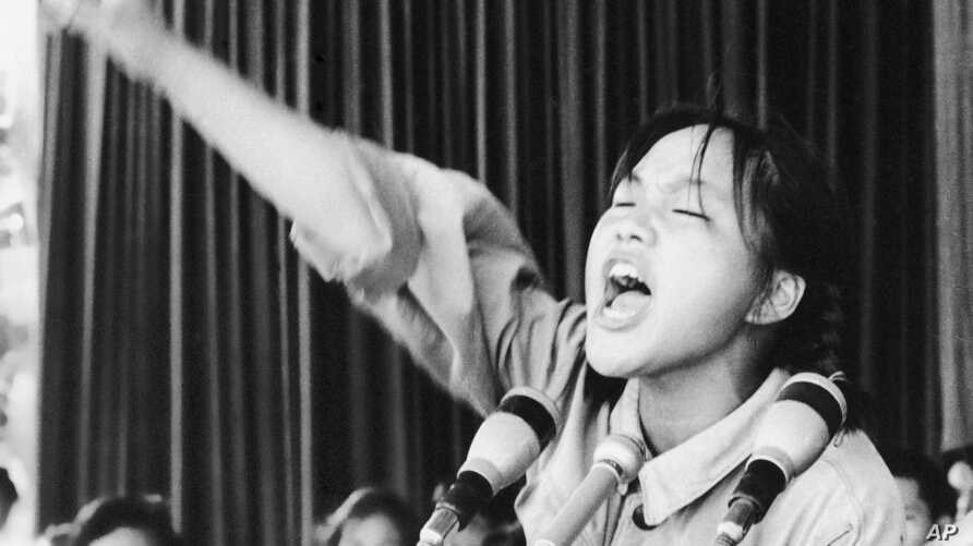 FILE -A young woman calls out to embolden her fellow Red Guards in Beijing's Tiananmen Square at the start of the 1966-76 Cultural Revolution, Aug. 10, 1966. May 16 is the 50-year anniversary of the start of the controversial campaign.