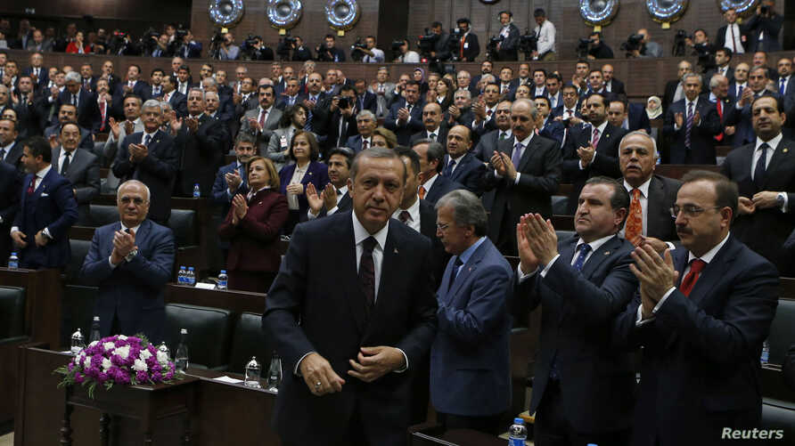 Turkey's Prime Minister Tayyip Erdogan leaves his seat to address members of parliament from his ruling AK Party (AKP) during a meeting at the parliament in Ankara, April 8, 2014.