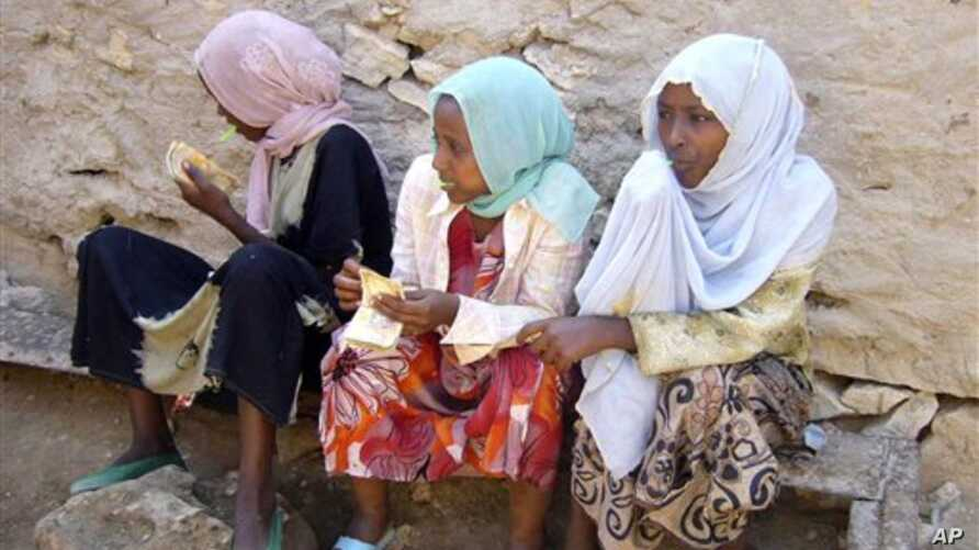 This image taken on Sunday Dec. 5, 2010, shows Ethiopian young girls waiting to travel to Yemen in Bossaso, the commercial city of the semi-autonomous region of Puntland and the launching pad of the people trying to cross the Gulf of Aden to Yemen.