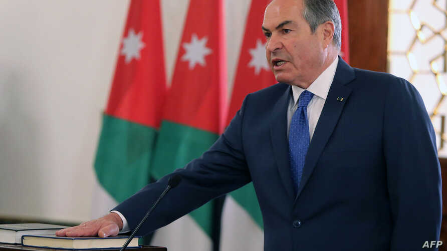 A handout picture released by the Jordanian Royal Palace on Sept. 28, 2016 shows Jordan's Prime Minister Hani Mulki taking a oath at the swearing in ceremony of Jordan's new government in Amman.