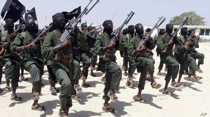 FILE - Hundreds of newly trained al-Shabab fighters perform military exercises in the Lafofe area 18 km south of Mogadishu, Somalia, Feb. 17, 2017.