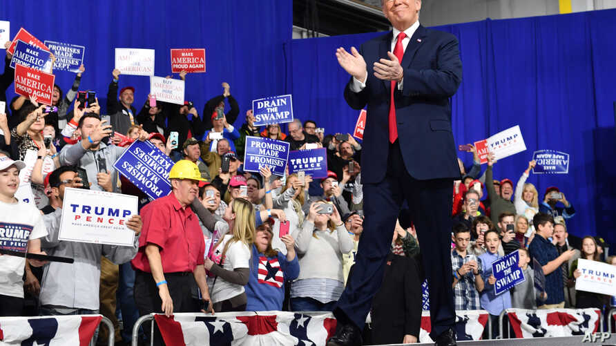 US President Donald Trump greets supporters at the Make America Great Again Rally on March 10, 2018 in Moon Township, Pennsylvania.