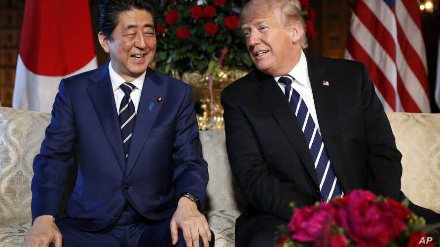 President Donald Trump and Japanese Prime Minister Shinzo Abe smile during their meeting at Trump's private Mar-a-Lago resort, April 17, 2018, in Palm Beach, Fla.