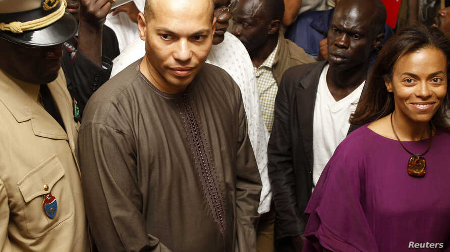 Karim Wade, second from left, and Sindiely Wade, right, children of Senegal's President Abdoulaye Wade, presidential elections, Dakar, February 26, 2012.