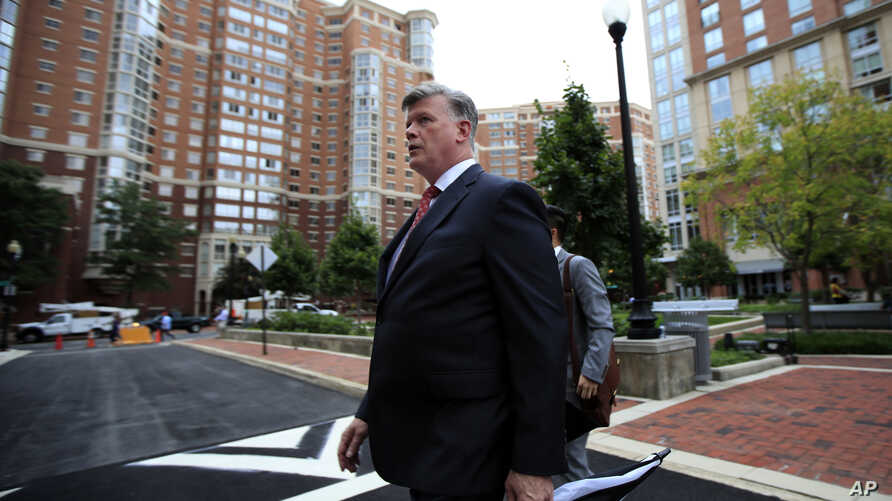 Kevin Downing, attorney for Paul Manafort, walks to the Alexandria Federal Courthouse in Alexandria, Va., Aug. 2, 2018, for President Donald Trump's former campaign chairman's tax evasion and bank fraud trial.