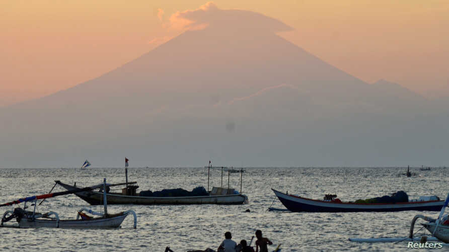 Mount Agung, an active volcano located on the resort island of Bali that has been placed on alert level 3 following recent seismic activity, is seen from Mataram on nearby Lombok island, Indonesia, Sept. 21, 2017, in this photo taken by Antara Foto.