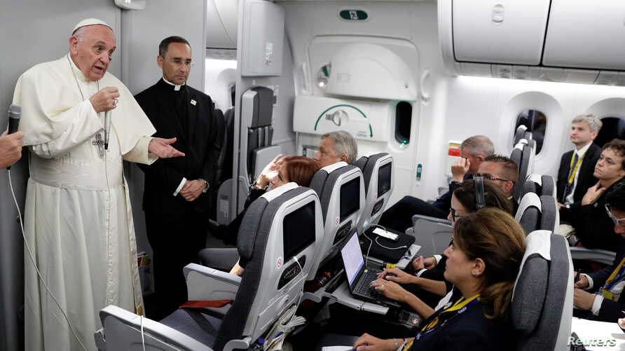 Pope Francis talks to journalists during a press conference aboard a plane to Rome at the end of his visit to Colombia, Sept. 11, 2017.