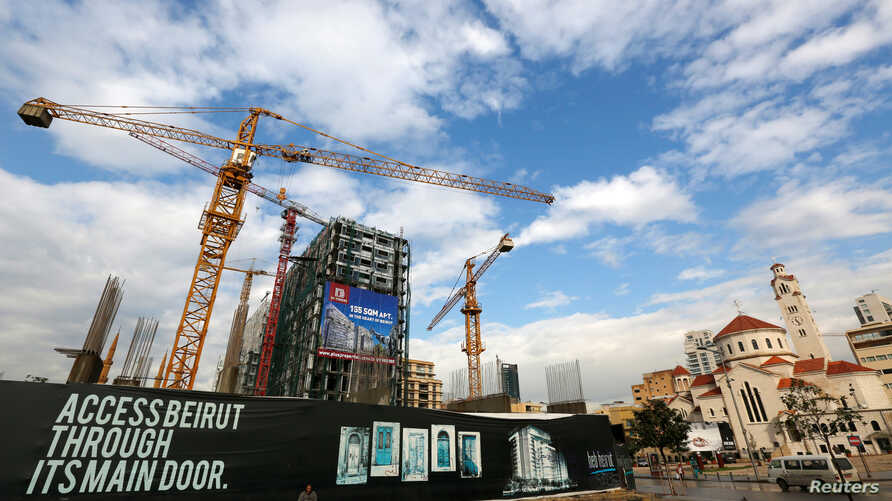 FILE - Cranes are seen at a construction site at Beirut's central district in Lebanon.