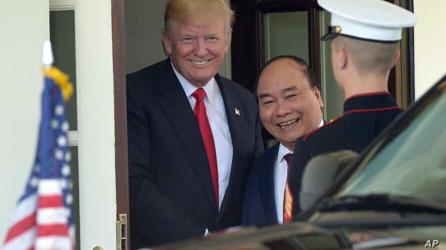President Donald Trump walks Vietnamese Prime Minister Nguyen Xuan Phuc to his car following their meeting at the White House in Washington, May 31, 2017.