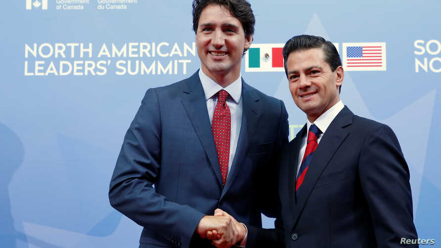 FILE - Canada's Prime Minister Justin Trudeau (left) greets Mexico's President Enrique Pena Nieto as he arrives for the North American Leaders' Summit in Ottawa, Ontario, Canada, June 29, 2016.