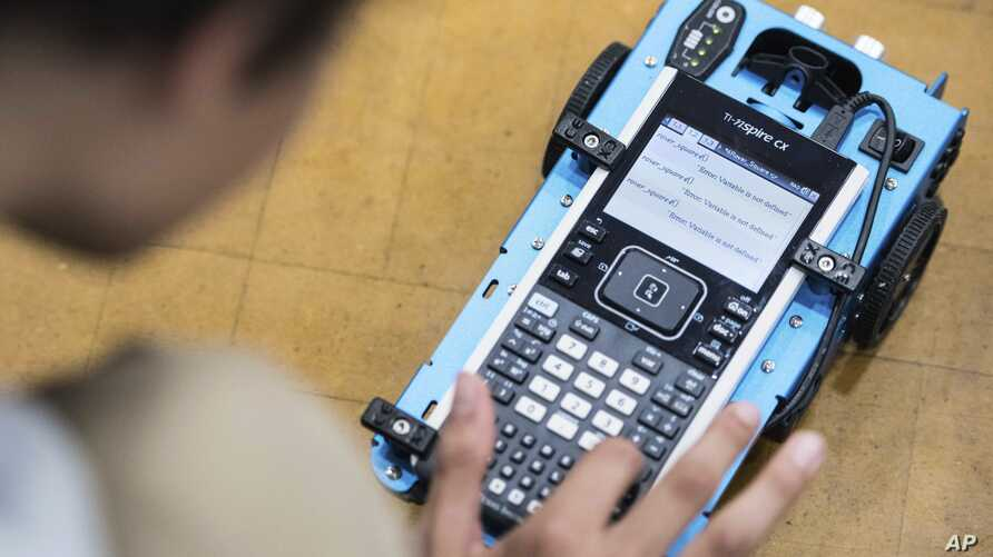 A student uses a Texas Instruments calculator at C.E. Williams Middle School on  May 22, 2018, in Charleston, South Carolina.