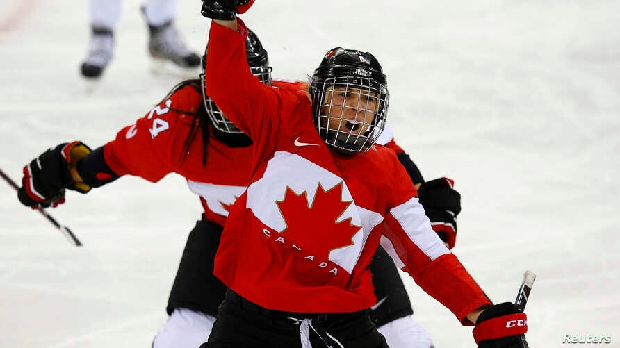 Canada's Meghan Agosta-Marciano celebrates after scoring what turned out to be the game-winning goal on Team USA's goalie Jessie Vetter (not shown) during the third period of their women's ice hockey game at the Sochi 2014 Sochi Winter Olympics, Feb.