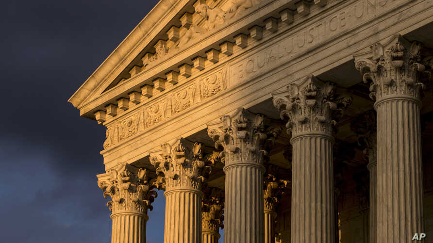FILE - In this Oct. 10, 2017, file photo, the Supreme Court in Washington is seen at sunset.