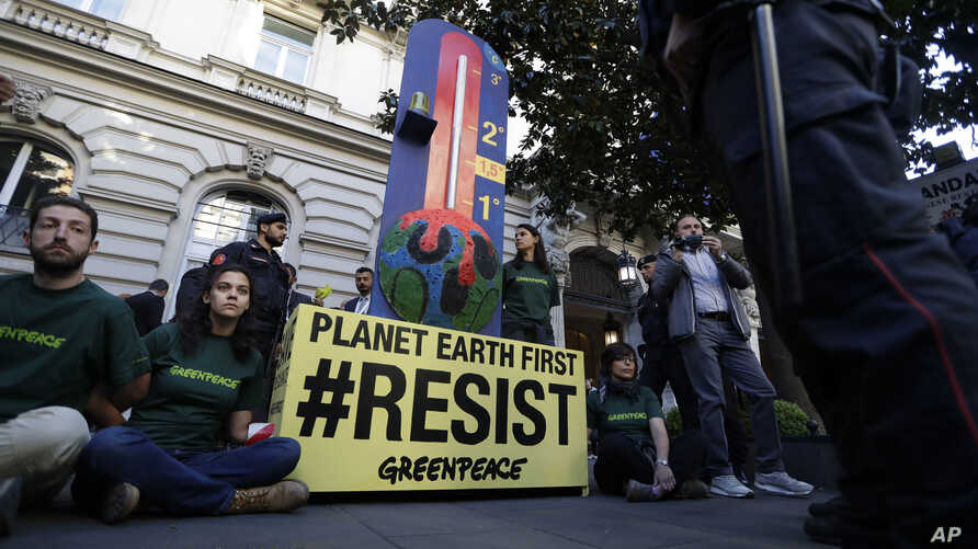 GreenPeace activists demonstrate outside a hotel hosting a G7 Energy meeting in Rome, Italy, April 10, 2017.