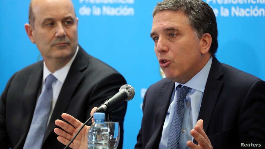 Argentina's Treasury Minister Nicolas Dujovne, right, speaks next to Argentina's Central Bank President Federico Sturzenegger during a news conference in Buenos Aires, Argentina, June 7, 2018.