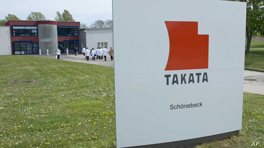 FILE - Journalists visit the production of pyro-electric airbag initiators at the international automotive supplier Takata Ignition Systems GmbH in Schoenebeck, Germany.