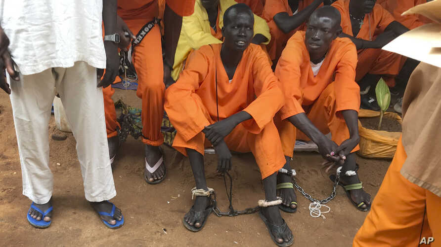This undated photo shows prisoners sitting together at the central prison in the capital Juba, South Sudan. A new Amnesty International report accuses authorities in South Sudan of torturing people to death in detention and letting many others langui