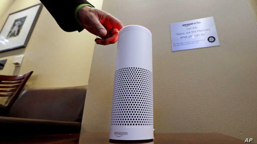 FILE - In this May 17, 2017 file photo, an Amazon Alexa device is switched on inside a ballpark suite at a Seattle Mariners game in Seattle.  Struggling retailer Sears is looking to get a hand from Amazon, announcing that it will start offering its K