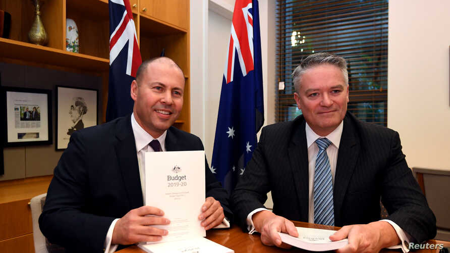 Treasurer Josh Frydenberg poses for a photograph with Minister for Finance Mathias Cormann with the 2019 Budget papers ahead of Budget 2019 at Parliament House in Canberra, Australia, April 2, 2019.