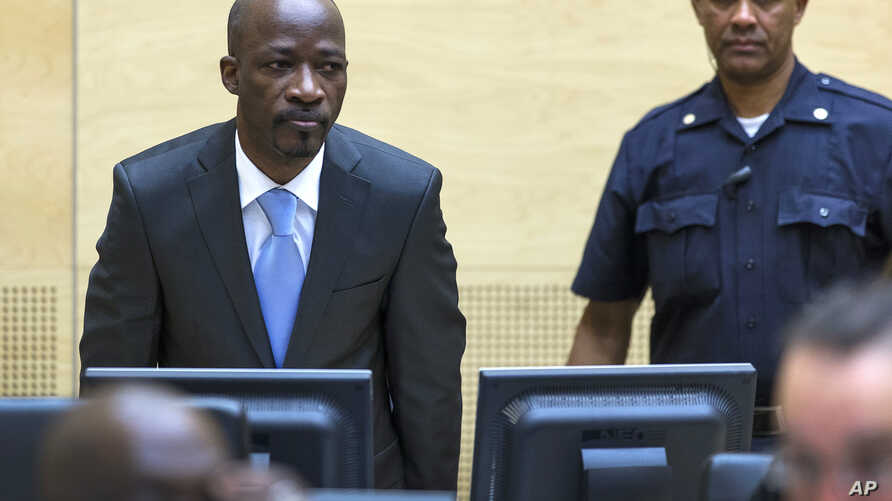 Ivory Coast's former youth leader Charles Ble Goude enters the courtroom for his initial appearance at the International Criminal Court (ICC) in The Hague, Netherlands, March 27, 2014.