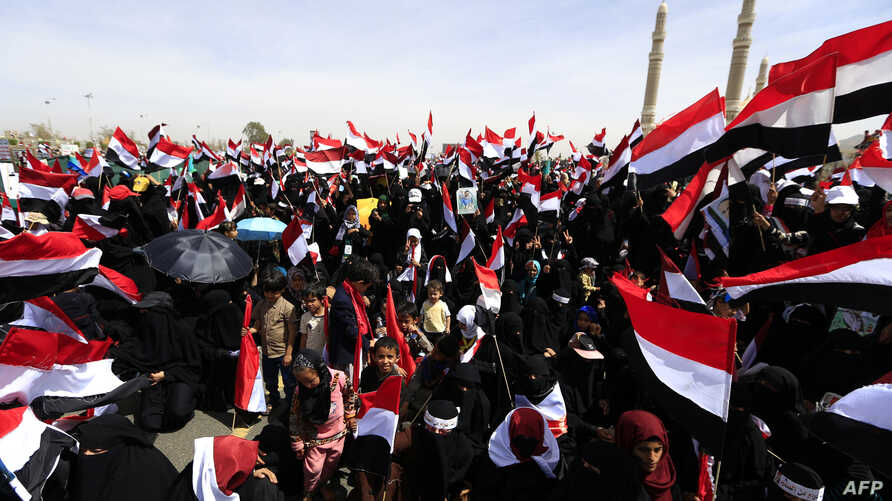 Supporters of Yemen's Huthi rebels attend a rally marking the fourth anniversary of the Saudi-led coalition's intervention in Yemen, in the capital Sanaa on March 26, 2019.