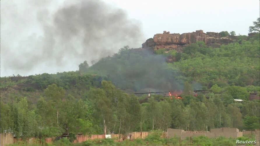 Flames rise following an attack where gunmen stormed Le Campement Kangaba resort in Dougourakoro, to the east of the capital Bamako, Mali in this still frame taken from video June 18, 2017.