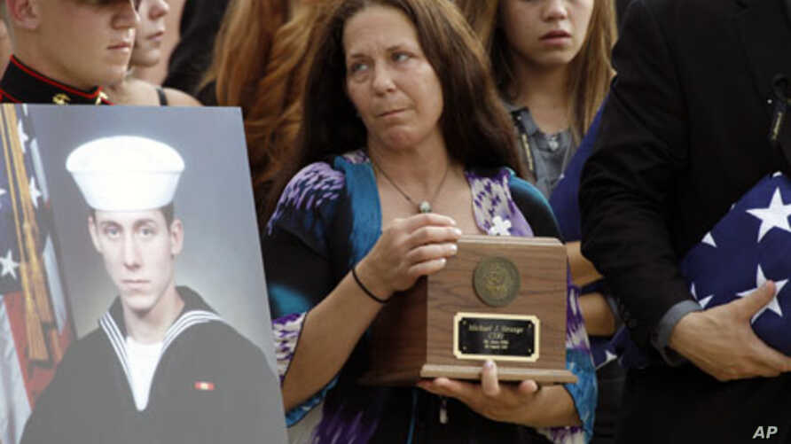 Elizabeth Strange, center, carries her son's remains,at a flag presentation ceremony for U.S. Navy Petty Officer 1st Class Michael Joseph Strange, in Philadelphia on August18, 2011. Strange was assigned to the Navy SEAL team whose Chinook helicopter