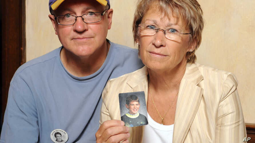FILE - Patty and Jerry Wetterling show a photo of their son Jacob Wetterling, who was abducted in October of 1989 in St. Joseph, Minn., and is still missing, in Minneapolis, Aug. 28, 2009. Patty Wetterling said Saturday that Jacob's remains have been
