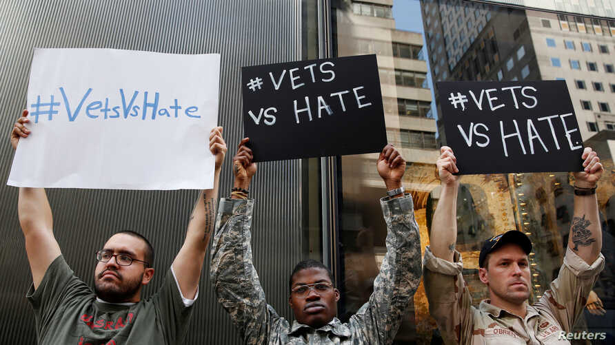 FILE - U.S. military veterans (R-L) Perry O'Brien, Claude Copeland and Julio Torres demonstrate outside Republican presidential candidate Donald Trump's news conference outside Trump Tower in New York, May 31, 2016.