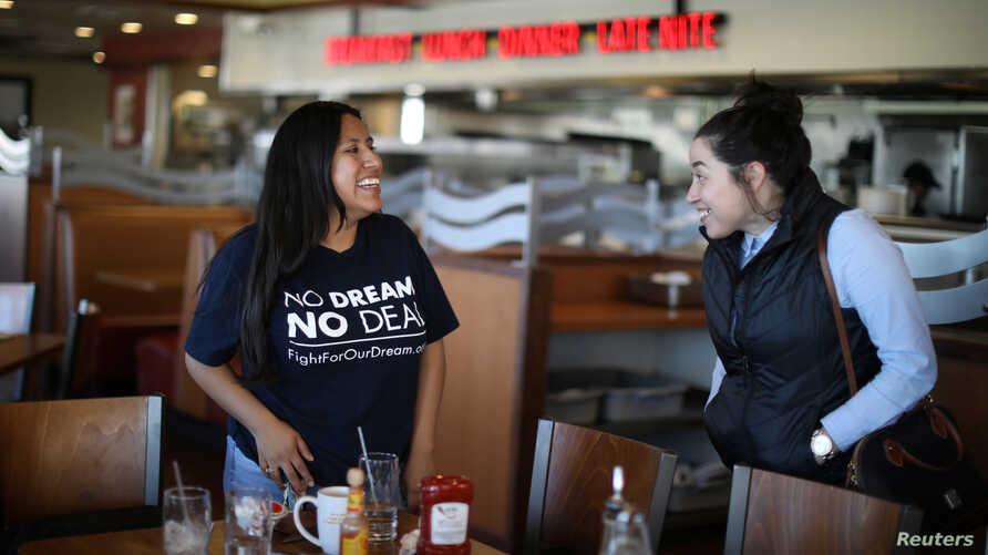 FILE - DACA recipient Barbara Hernandez (L), 26, chats to a friend after eating lunch in a diner in Garden Grove, California, U.S., Jan. 22, 2018.