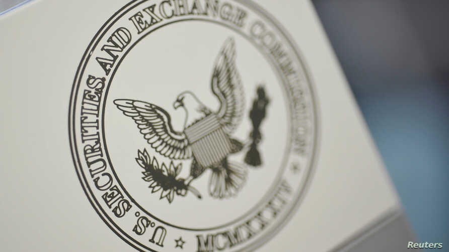FILE - The U.S. Securities and Exchange Commission logo adorns an office door at the SEC headquarters in Washington.