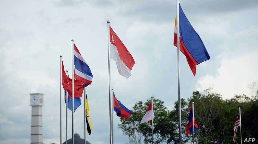 The flags of member nations of the Association of Southeast Asian Nations (ASEAN) are pictured in Bandar Seri Begawan, April 24, 2013.