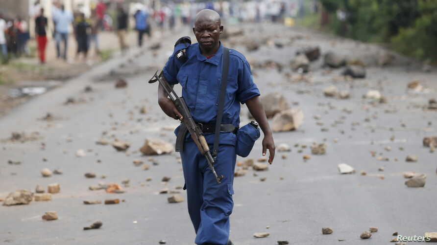 A policeman holds his rifle during a protest against Burundi President Pierre Nkurunziza and his bid for a third term in Bujumbura, Burundi, May 20, 2015.