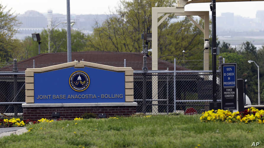 FILE - The gate for the Joint Base Anacostia-Bolling is seen in Washington, D.C., April 17, 2013. The base was one of the Washington-area sites that received suspicious packages Monday.