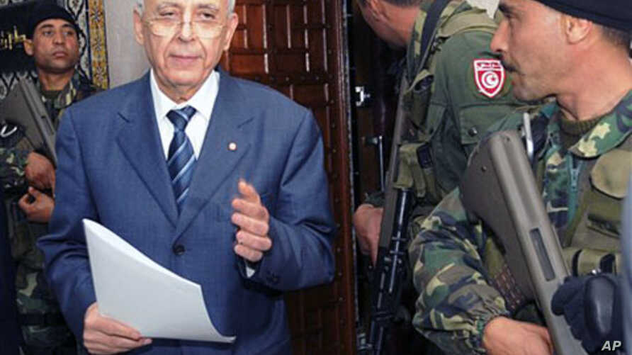 Tunisian PM Mohamed Ghannouchi arrives to announce a national unity government in Tunis, 17 Jan 2011