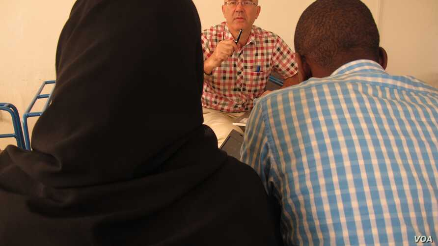 UNICEF's Grev Lester Hunt meets with Ebola survivors who are forming a support group in Conakry, Guinea, on Sept. 29, 2014.
